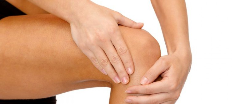 fitness, healthcare and medicine concept - close up of female hands holding knee